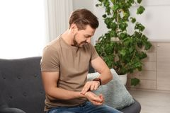 Man checking pulse with fingers stock photo