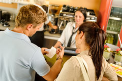 Man checking receipt at cafe payment. Man checking receipt at cafe restaurant payment waitress couple bar Stock Photo