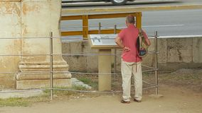 Man checking reference information at exhibition, sightseeing tour around city. Stock footage stock video footage