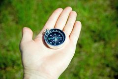 Man checking retro compass for directions Royalty Free Stock Photos