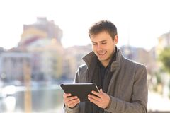 Man checking a tablet in winter royalty free stock image