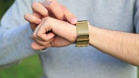 Man checking the time on his wrist watch stock footage