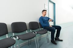 Man checking time in hospital Stock Photo