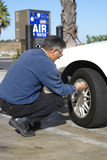 Man Checking Tire Pressure Royalty Free Stock Photo