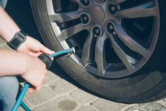Man checking tires before long trip Royalty Free Stock Photography