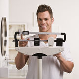 Man Checking Weight royalty free stock photo