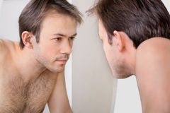 Man checks his reflection Stock Photo