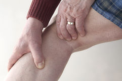 Man checks pain in his leg Stock Images