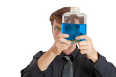 Man checks physical properties of liquid in bottle Stock Photos
