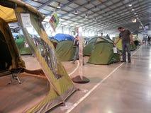 Man checks price of tent. On tent exhibition, Prague, Czech Republic Royalty Free Stock Photo