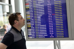 Man checks the schedule of planes Royalty Free Stock Photo