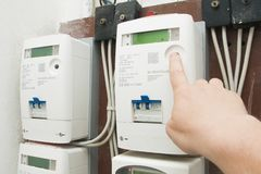 Free Man Checks The Consumption On The New E-distributione Enel Electricity Meter Stock Image - 153032831