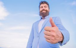 Man cheerful bearded businessman show thumbs up sky background. Hipster show thumbs up. Success and approval concept. Gesture expresses approval. Business stock images