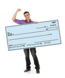 Man Cheering And Holding Up Giant Blank Check Royalty Free Stock Photo