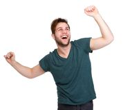 Man cheering with arms outstretched Stock Photo