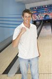 Man Cheering At Bowling Alley Royalty Free Stock Photos