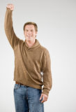 Man cheering and celebrating his success royalty free stock image
