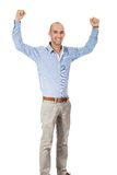 Man cheering in jubilation. To celebrate an achievement or success raising his fists and punching the air, isolated on white stock photo