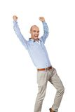 Man cheering in jubilation. To celebrate an achievement or success raising his fists and punching the air, isolated on white royalty free stock images