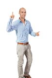 Man cheering in jubilation. To celebrate an achievement or success raising his fists and punching the air, isolated on white stock photography