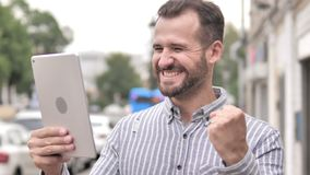 Man Cheering for Success on Tablet Outdoor. 4k high quality, 4k high quality stock footage
