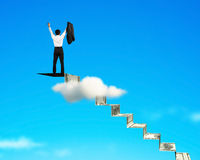 Man cheering on top of money stairs Stock Photography