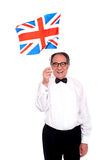 Man cheering for United Kingdom. Waving flag. Isolated over white stock image