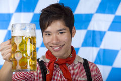 Man cheers with Oktoberfest beer stein (Mass) Royalty Free Stock Images