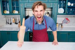 Man chef in apron shout with anger with rolling pin Royalty Free Stock Images