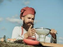 Man chef bolting flour Stock Photos