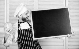 Man chef hat apron hold blackboard copy space. Recipe concept. Cooking delicious meal step by step. Menu for today. List. Ingredients for cooking dish. Check royalty free stock images