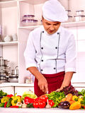 Man in chef hat cooking. Stock Photos