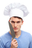 Man with chef hat and knifes Royalty Free Stock Photography