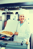 Man chef holding pizza Royalty Free Stock Images