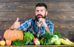 Man chef with rich autumn crop. seasonal vitamin food. Useful fruit and vegetable. harvest festival in autumn. organic. And natural food. happy halloween royalty free stock photo