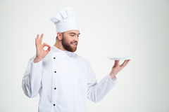 Man chef showing ok sign and empty plat Royalty Free Stock Image