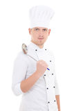 Man in chef uniform with sauce spoon isolated on white Stock Photo