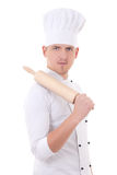 Man in chef uniform with wooden baking rolling pin isolated on w Stock Image
