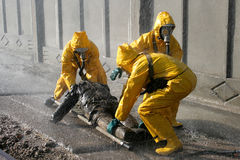 Man in chemical protection suit Stock Images