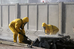 Man in chemical protection suit. Carrying out the decontamination area Stock Photos