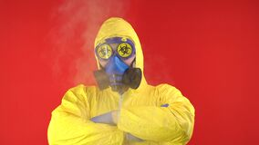 A man in a chemical protective suit, around couples, in a protective mask and glasses is a sign of Biohazard. The
