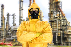 Man in chemical protective suit. Over factory Royalty Free Stock Images