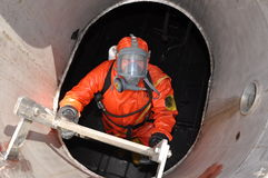Man in chemical suit Stock Photography