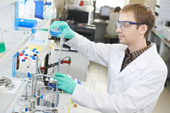 Man chemist scientist researcher in laboratory. One male scientist researcher making research in chemistry laboratory Royalty Free Stock Photography