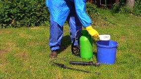 Man with chemistryproof clothing hand pour fertilizer to spray Royalty Free Stock Images