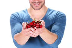 Man with cherry Royalty Free Stock Photos