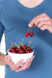 Man with cherry Stock Photos