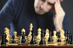 Man at chess board Royalty Free Stock Image