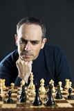 Man at chess board Stock Photos