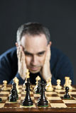 Man at chess board Stock Photography